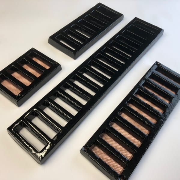 75 mm high slotted gratings custom made available painted black , with or without mesh - drilled or undrilled