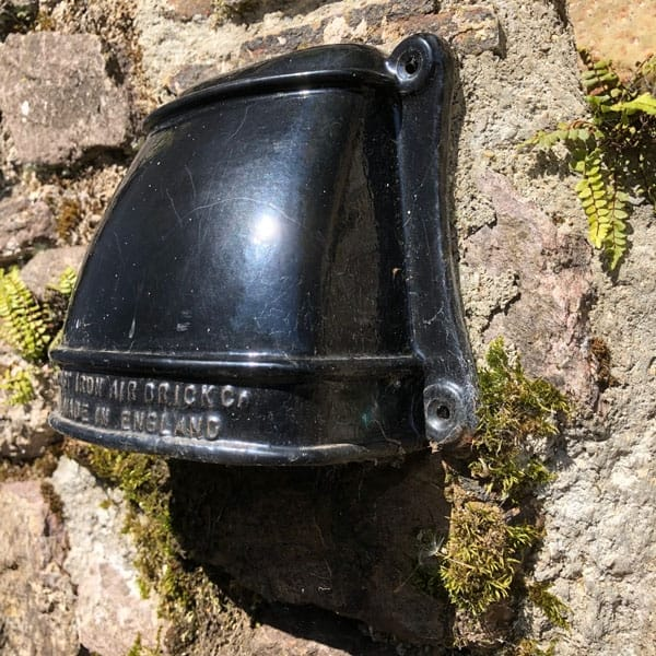 Cast iron cowled conservation air vent several years after installation