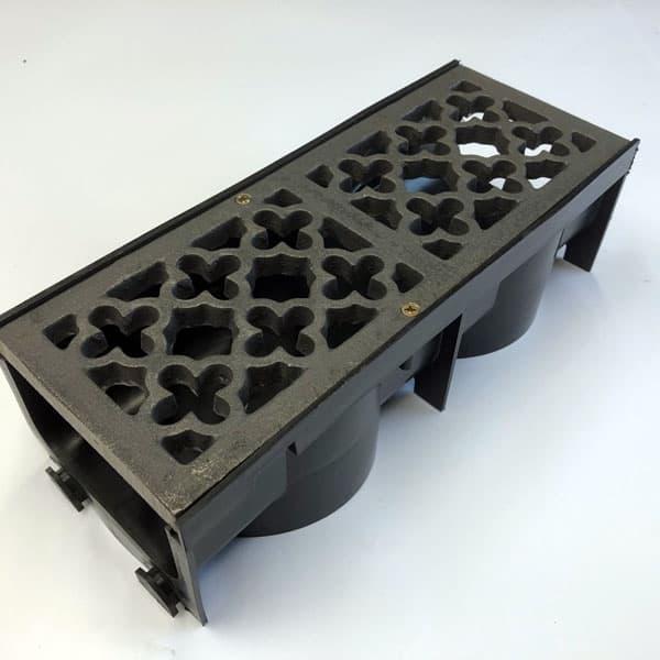 Item Q300 - 289mm quatrefoil cast iron channel gratings bare metal with channel