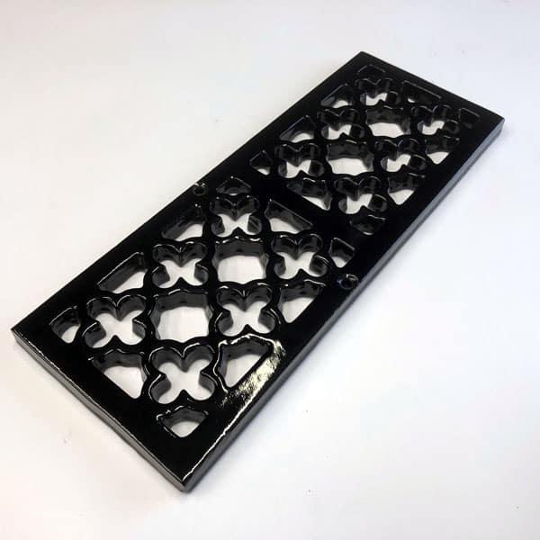 Item Q300 - 289mm quatrefoil cast iron channel gratings painted black without channel